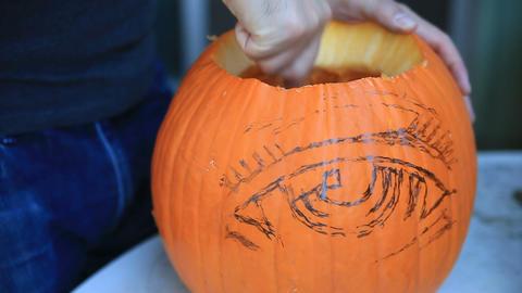 Scraping out Halloween pumpkin Footage