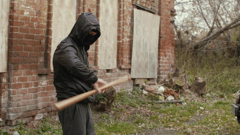 Street hooligan is holding twisting a baseball bat Live Action