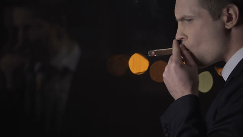 Company owner anxiously smoking cigar, planning business strategy, decision Footage