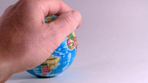 a hand of a man, caresses a globe, ideal footage to explain problems of ecology Photo
