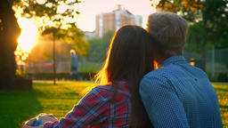Two lovely people in love are sitting closely in amazing... Stock Video Footage