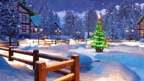 Snowy alpine mountain township at Christmas night GIF
