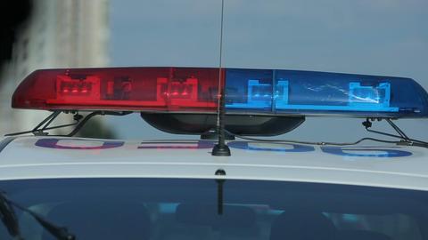 Flashing strobe lights bar on police transport, patrol car crime scene, signal Footage
