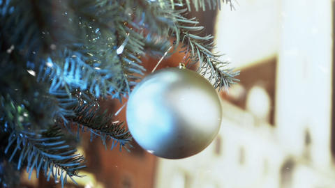 Snow falling on beautiful New Year toy decorating Christmas tree, close-up ビデオ