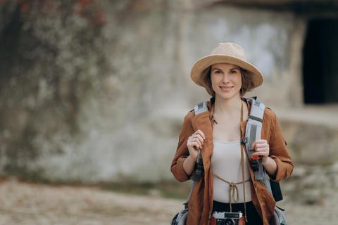 Portrait of happy traveler girl enjoying valley view, mountains landscape Photo