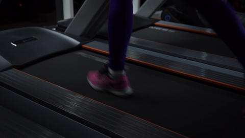 Women's legs on the treadmill Live Action