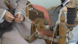 Woman is spinning wool on a spinning wheel 10 Live Action