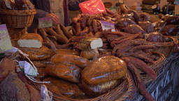 Farmers market. Traditional meats and sausages Live Action