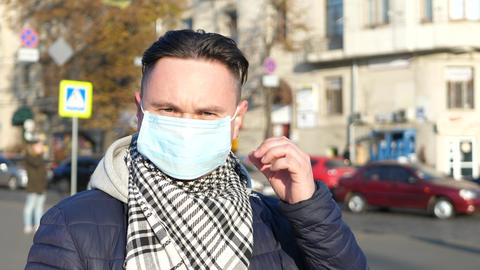 Man in mask in polluted city covered with heavy smog GIF