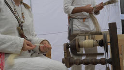 Woman is spinning wool on a spinning wheel 7 Live Action