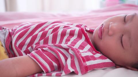 Boy sleeping on bed Footage