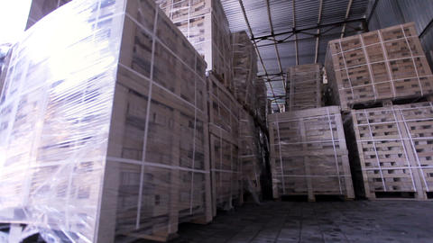 Production of plywood in a furniture factory. Storage room with packed plywood Footage