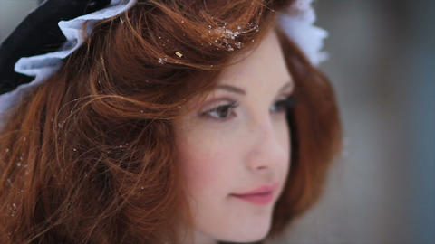 Portrait of a red-haired girl in an ethnic costume. Cinderella. Fairy-tale Footage