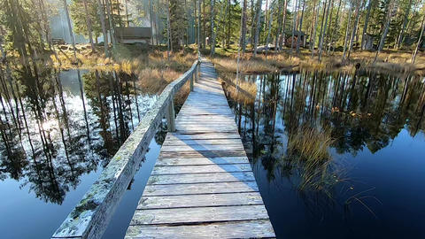 Walking on wooden dock towards a national park fireplace Footage