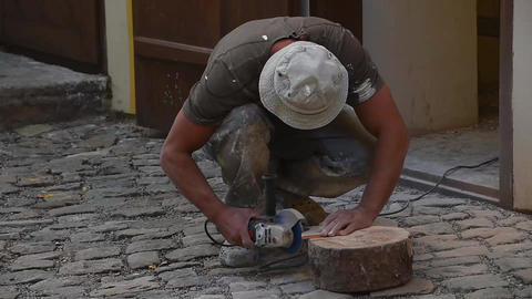 Man cutting ceramic tile with angle grinder Footage