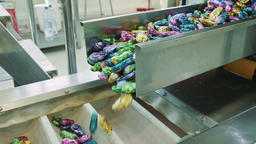 Candy factory. Sweets spilling from conveyor Live Action