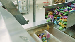 Sweets spilling from conveyor. Candy factory Live Action