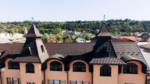 Aerial view of the new brown tiled roof with a weather vane Fotografía