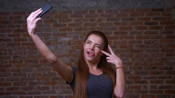 Amazing caucasian ginger female is showing her happiness while taking selfie Footage