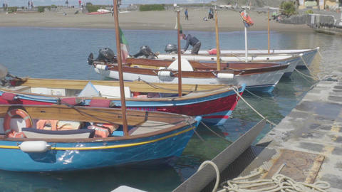 ISCHIA, ITALY - CIRCA JULY 2014: People on the island. Moored motorboats tied up Live Action