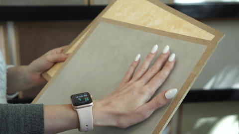 Hands hold samples of interior decoration materials and make a choice Live Action