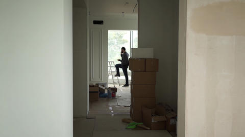 man stands in the repaired apartment Footage