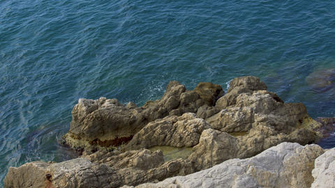 Calm sea waves washing rocky cliff, beautiful nature, relax and recreation Live Action