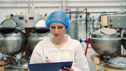 Controller checking confection factory. Candy factory Footage