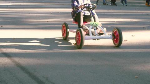 A child rides a four-wheeled bike Footage