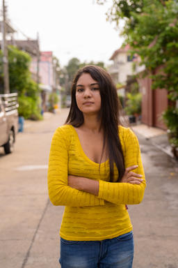 Young Indian woman with arms crossed in the streets outdoors Photo