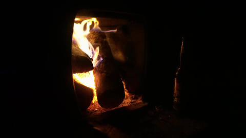 4K Relaxing warm firepit in a cold night in a small oven to warm Footage