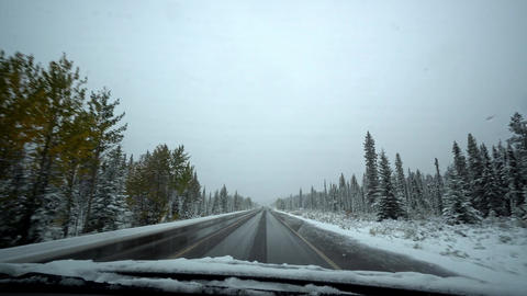 4k view driving on an icy road on the icefield parkway Footage