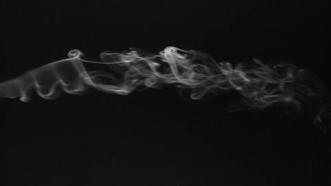 Beautiful twists of white smoke on a black background. smoke background Footage