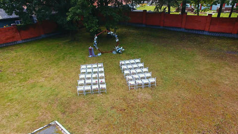 aerial view wedding ceremony with arch decorated with cloth and flowers outdoor Footage