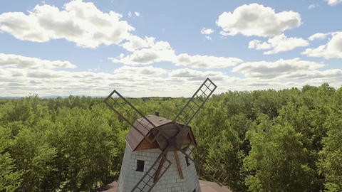 aerieal front view old windmill located near forest Footage