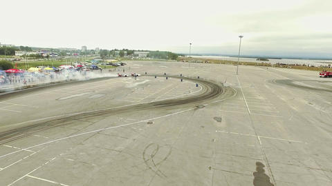 Aerial shot of cars drifting with lots of smoke during drift competition Footage