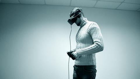 Man in a virtual reality helmet Footage