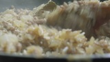 FRYING MINCED MEAT WITH ONION AND RICE stock footage