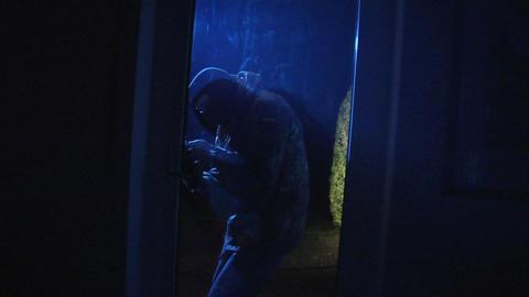 burglar open porch door comes in 10840 Stock Video Footage