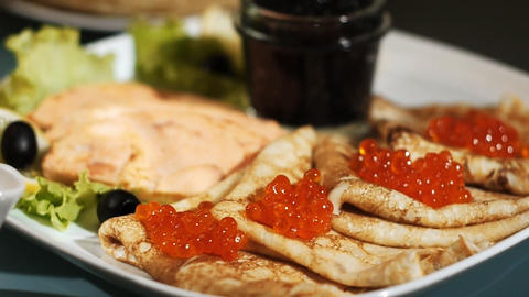 Pancake with red caviar Stock Video Footage