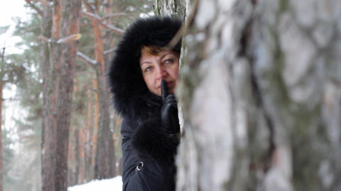 woman shows gesture in winter wood Footage