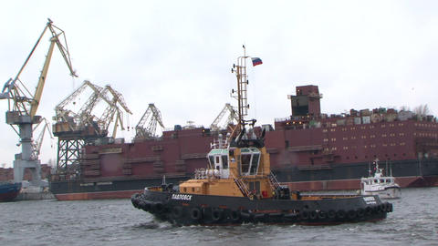Tug-boat floats on the river Stock Video Footage