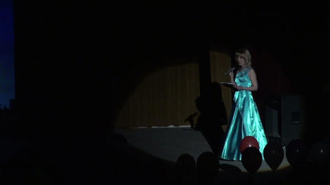 The actress on the stage in a beam of light Stock Video Footage