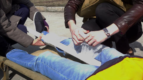 Paramedics immobilize victim's leg Footage