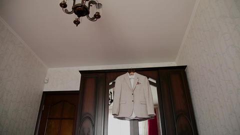 Men's stylish jacket hanging on the closet Footage
