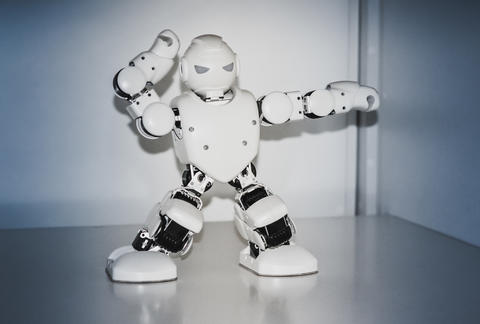Small cyborg robots, humanoids with face and body dances to music フォト