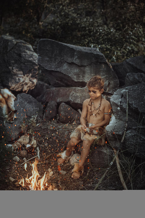 Shamans boy at the fire Photo