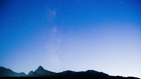 Timelapse from blurred night stars over the valley GIF
