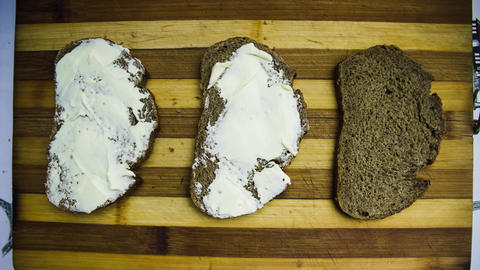stop motion animation from three pieces of the bread covered with butter and GIF