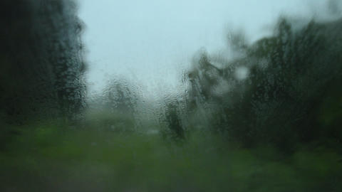Raindrops run down the misted glass of the car Footage